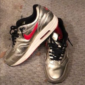 Nike air max 1 gold leather sneakers